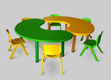 Bean shaped table with 6 chairs for the preschollers in yellow and green color
